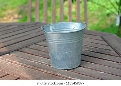 A tin pot on a table top
