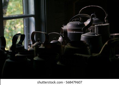 Tin Pots and Kettles in a Dark Room by the Window