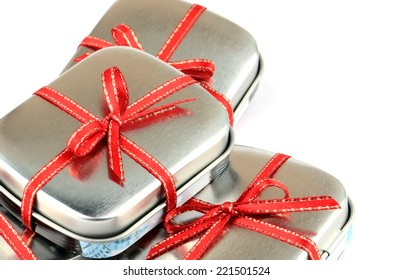 Tin Present Box with Red Ribbon.