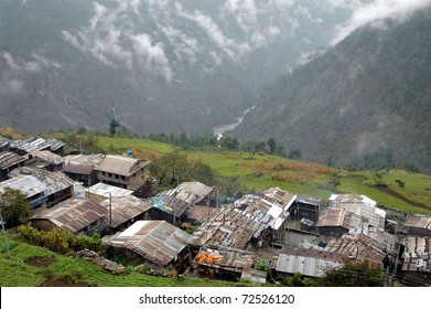 Tin roofs held down with rocks are all that protect the inhabitants from cold weather in winter and monsoon rains in the summer in this developing country