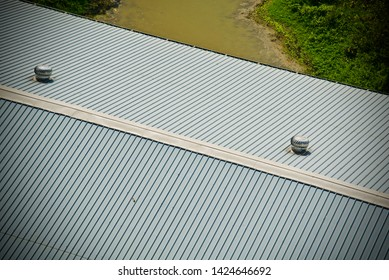 A tin shed rooftop of a factory building isolated object photo