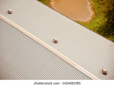 Tin shed rooftop of a modern building isolated object photo