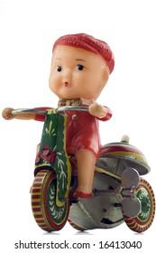 tin windup toy - boy riding bicycle