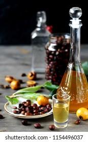 tincture alcoholic on bones loquat . Amaretto with almond flavor. recipe for medlar. Loquat seed liquor. alcoholic beverage from the  loquat. tincture on seed loquat. liquore nespolino