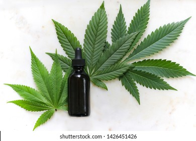 Tincture bottle. Full spectrum. Cannabis herb and leaves for treatment (broth, tincture , extract, oil). Indica Sativa Hybrid CBD.