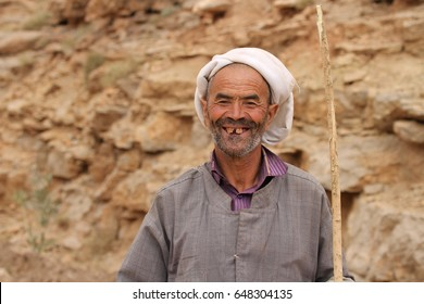 TINERHIR, MOROCCO - AUGUST 20:  A closeup of a nomad shepherd of the Berber tribe walking at Todgha Gorge, Tinerhir, Morocco on the 20th August, 2015.