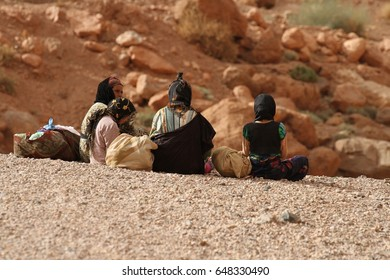 TINERHIR, MOROCCO - AUGUST 20: A group of nomadic women of the Berber tribe sitting on a cliff top at Todgha Gorge, Tinerhir, Morocco on the 20th August, 2015.