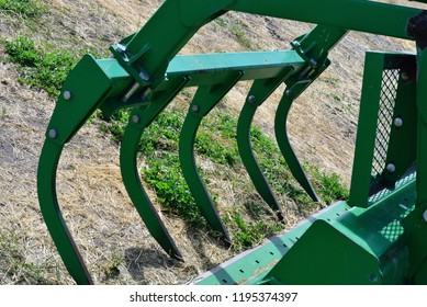 Tines for holding round bales of hay.