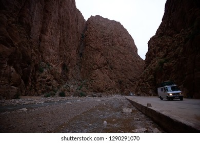 Tinghir, Morocco - October 22, 2018: Two white vehicles riding down the road in the Todra gorge