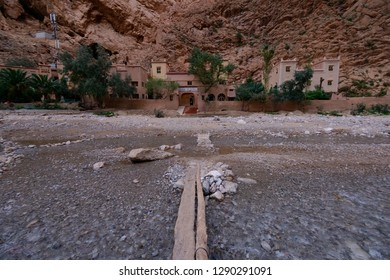 Tinghir, Morocco - October 22, 2018: Flimsy bridge across the fast mountain river in Todra Gorge to KAsbah Les Roches, used as a hotel