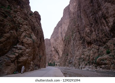 Tinghir, Morocco - October 22, 2018: Man in traditional moroccan clothes walking down the road in the Todra gorge