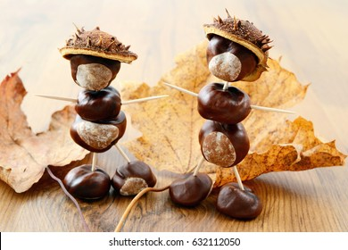 tinker little chestnut figures made of nuts and leaves.