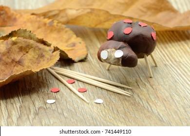 tinker small ladybug figure made of chestnut and teeth sticks.