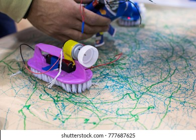 Tinkering trash toys activities. STEAM activity for classroom. Brush with motors, felt-tip pens and batteries, game for children to discover electricity and mechanical movement