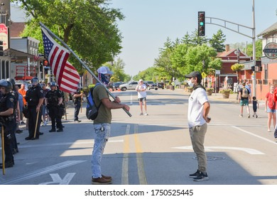 Tinley Park, Illinois / USA-June 2, 2020: Protesters gather in the downtown area to protest the killing of George Floyd, police brutality & black lives matter shutting down the main street in the city