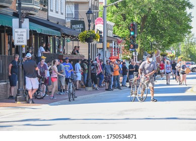 Tinley Park, Illinois/USA-June2,2020: Protesters demonstrate on the main street against police brutality, violence and the killing of George Floyd, supporting the black lives matter movement