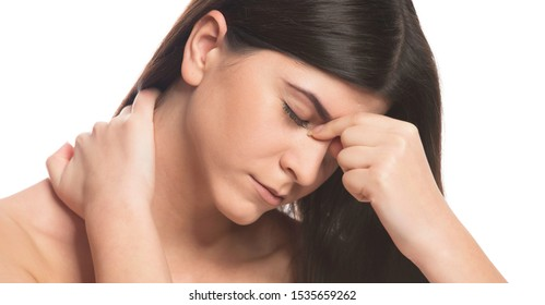 Tinnitus. Closeup up side profile sick female having ear pain touching her painful head