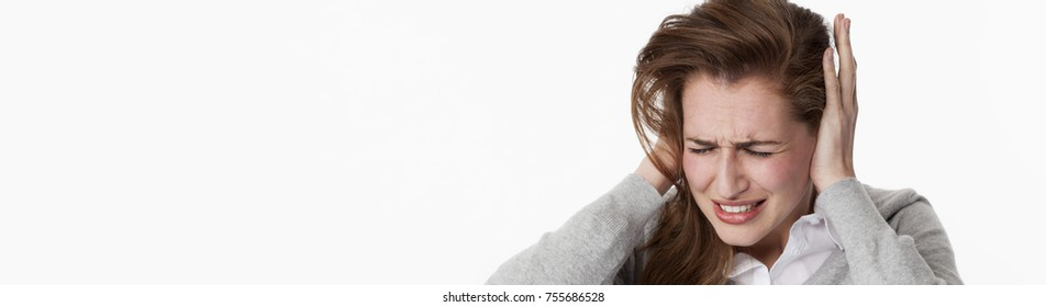 tinnitus concept - stressed out young woman having painful migraine,covering closed ears,annoyed by loud noise not wanting to hear their side of story, long banner