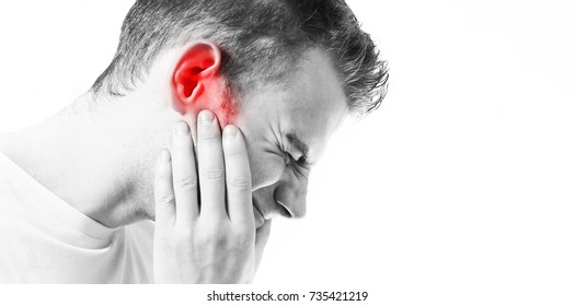 Tinnitus,  man on a white background holding a sick ear, suffering from pain