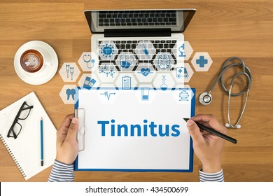Tinnitus Top view, Doctor writing medical records on a clipboard, medical equipment