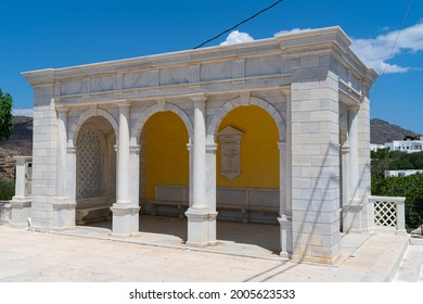 Tinos, Greece - June 12 2021: Bus station made with marble at Pyrgos (Panormos) village