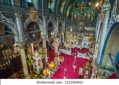 TINOS - GREECE, MARCH 2017: The interior of Panagia Megalochari church (Virgin Mary) in Tinos, It is the patron saint of Tinos island and considered as the saint protector of Greece. Cyclades - Greece