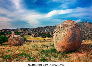 """TINOS ISLAND, CYCLADES, AEGEAN SEA, GREECE. Surreal landscape with huge, round and smooth rocks close to Volax (or """"Volakas"""") village."""