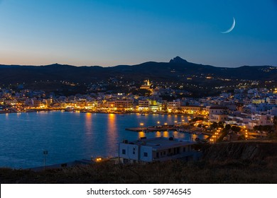 Tinos island at Cyclades, Greece in the evening with moon rising above the sky