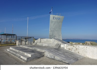 "Tinos island, Cyclades / Greece - May 10 2019: Iconic memorial monument of Greek Navy warship ""Elli"" that was bombed and sunk in port of Tinos islnad"