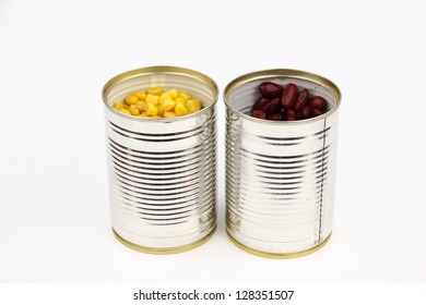 The tins with red bean, corn on the white background