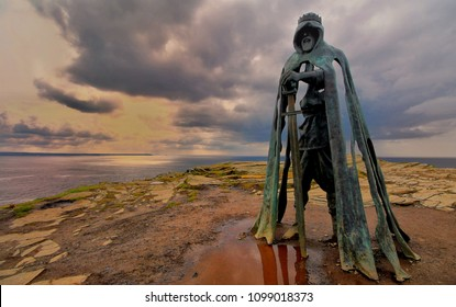 Tintagel, Cornwall, UK - April 10 2018: The King Arthur statue Gallos by Rubin Eynon stands on a rocky headland on the Atlantic coast of Cornwall