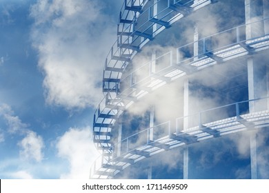 Tinted background of concrete-metal structures for design on an architectural, construction theme. Fragment of an unfinished multi-story residential building or commercial property in the clouds