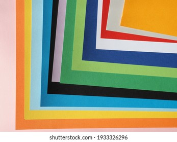 Tinted cardboards of many different colours including pink orange yellow blue black green white and red