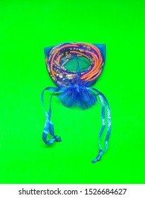 TINY AFRICAN WAIST BEADS PACKAGED IN ORGANZA