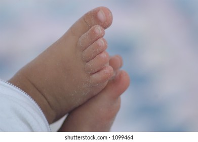 Tiny Baby toes with Sand on them