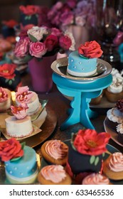 Tiny blue table with little cake on the top