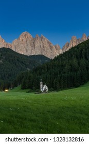 Tiny Church of San Giovanni in South Tyrol's Val di Funes in front of Dolomite mountain, Italy.