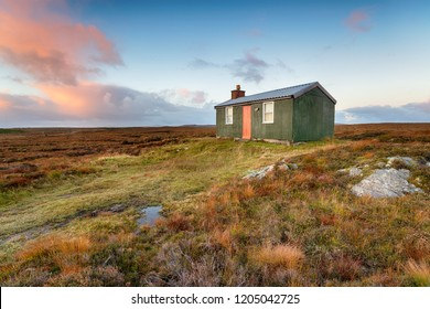 A tiny cottage or hut known as a shieling which is used for shelter while pasturing animals, on peat bog near Stornoway on the Isle of Lewis in Scotland
