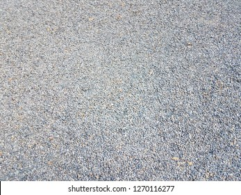 tiny grey and blue pebbles or gravel on the ground