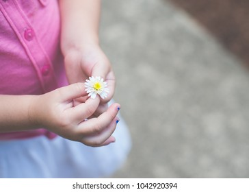 Tiny hands for a tiny flower