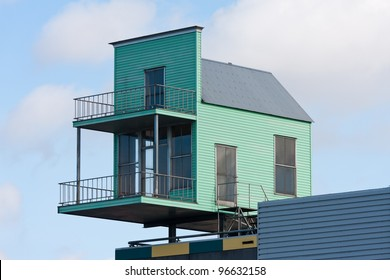 Tiny house at the top of a bigger building