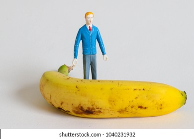 Tiny man with huge banana.