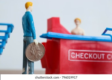 Tiny man stands in line at a store checkout with giant coin in hand. Concept of big spending or big savings. Cashier and customer interaction. Retail purchasing and saving on your grocery bill.