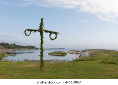Tiny maypole, small harbor and the sea in the background. No people