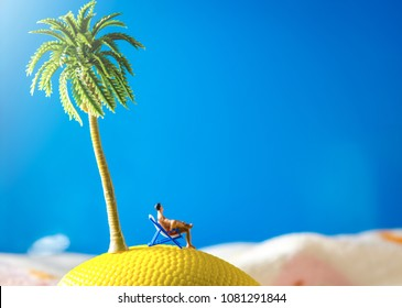 tiny miniature man sitting at beach chair looking at sea