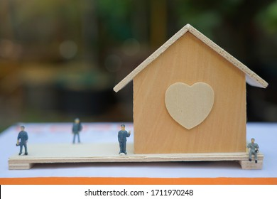 Tiny model near wooden house conceptual real estate or quarantine stay at home with family
