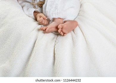 Tiny newborn baby feet and hands, concept of happy family. copy space.