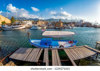 Tiny old boat moored in Kyrenia harbor. Cyprus.