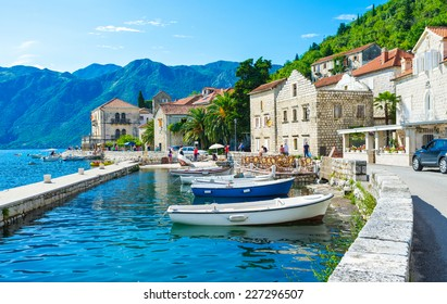 The tiny port in the city centre of Perast makes it even more idyllic and cozy, Montenegro.