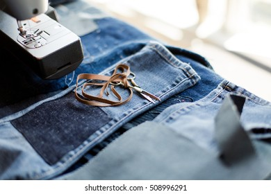 Tiny Scissors on Freshly Patched Children Jeans